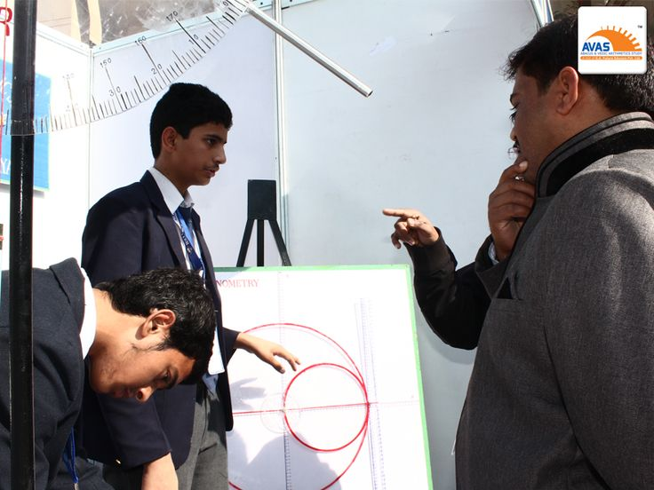 Students explaining their model to Maths teachers from different schools attending National Maths Expo at IIT, Delhi, organized by Avas India