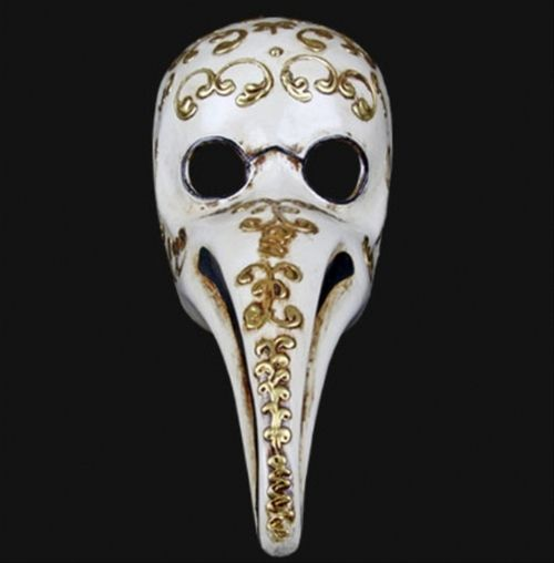 Naso Peste Decor Plague Doctor Masquerade Mask - Each hand finished mask might vary in decoration, adornments and style.Hand made in Venice, this piece comes straight from European history. Doctors would wear this mask and stuff the nose with herbs to filter the plague infested air. The base is an ivory couour with three dimensional gold filigree swirls and decorations. The glasses are painted on in black and a line down the nose. #yyc #costume #mask #venetian