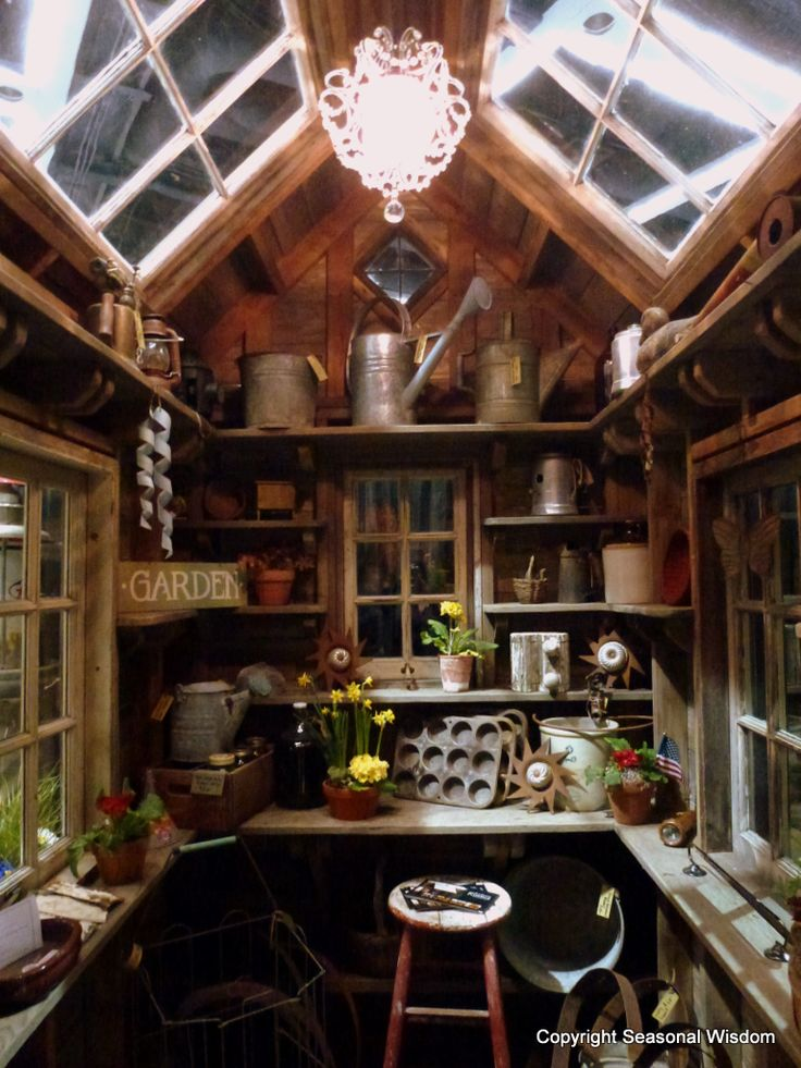 Speaking of garden sheds, here's another magical one that you can actually custom order from a company called Bob Bowling Rustics, which was displaying at the show.  I loved the crystal chandelier that hung in this rustic shed, don't you?