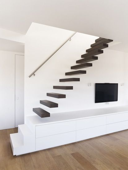 floating stairs combined with build in tv unit. love it