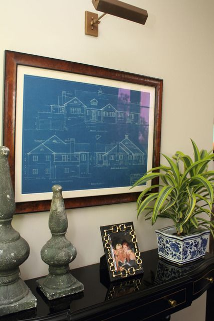a framed blueprint of the house on the wall... meta AND adorable. Doing this for our office with our prints very cool.