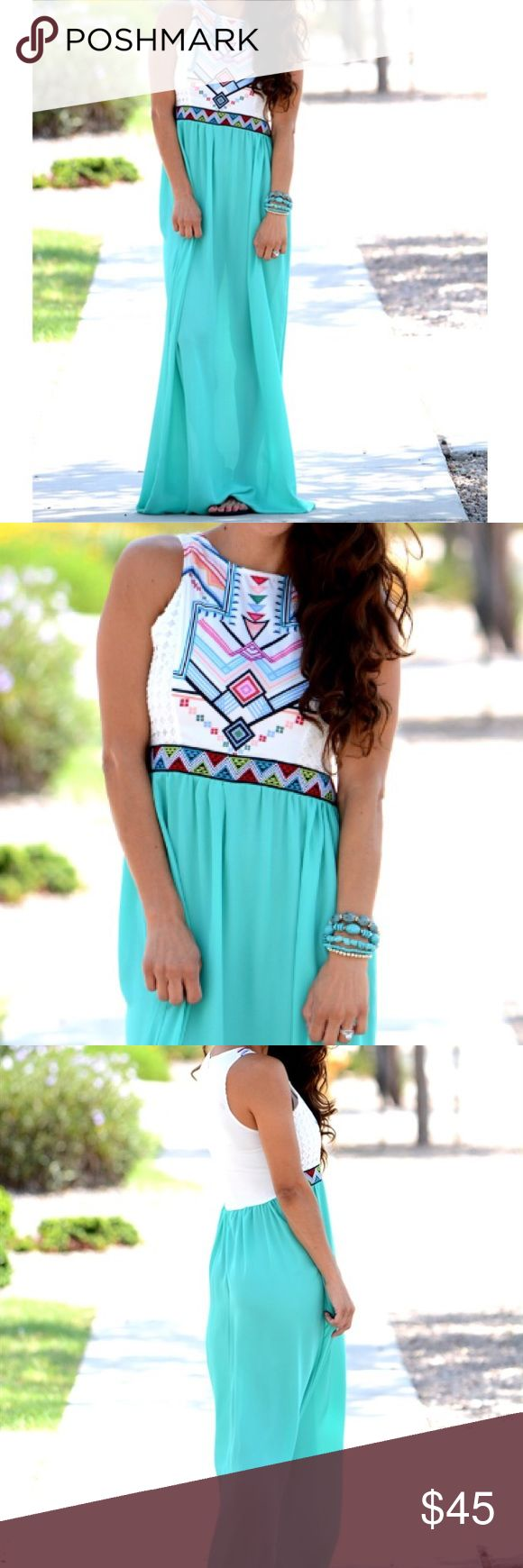 """Aztec Max dress With the bright, vibrant colors, you will definitely stand out from the rest of the crowd in this Aztec maxi dress. Dress it up with a pair of wedges, or make it more casual with some steal it sandals. It's the perfect dress for any occasion, from a dinner date, to a casual walk in the park. Not lined, so you will need a slip under this one. Runs slightly small, fits 4-6 best. Bust:19"""" with tiny bit of stretch, length:50"""" total. Dresses Maxi"""