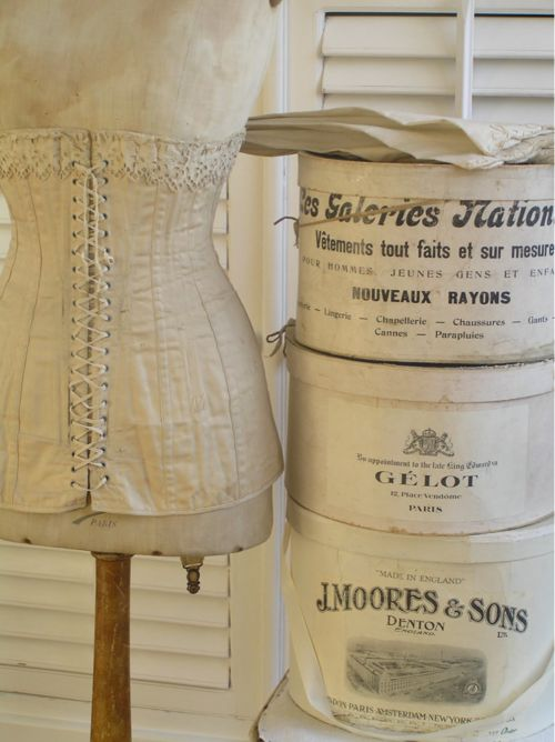 love the vintage corset and hat boxes - the colors are so vintage!