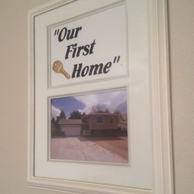 Our first home framed with key and a picture of our home