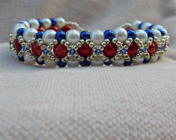 Keep it classy while showing your patriotism!! This super cute bracelet is made with White and Cobalt Blue Glass Pearls and Shiny Red Glass beads. Embellished with Permanent finish galvanized silver seed beads. Finished with a silver toned heart toggle. Available in 7 1/2 inches, 7 3/4 inches and 8 inches.  Item ships in an organza drawstring bag and padded envelope via USPS **Free shipping within the United States**
