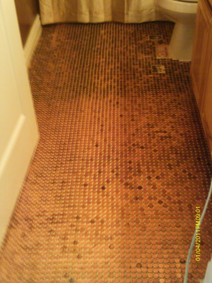 almost completed 'penny floor'  just have to have a sola-tube installed in the ceiling to make it sparkle