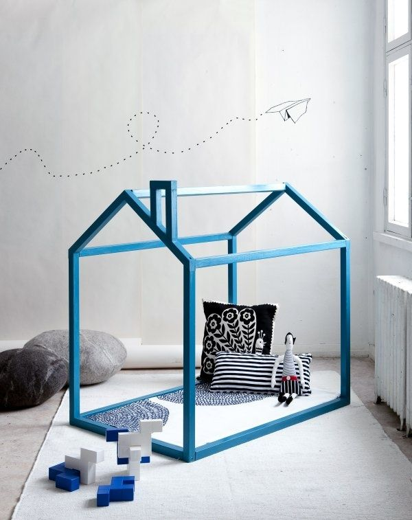 love this house! the simplicity, the felt rocks and the marimekko accessories. wow.