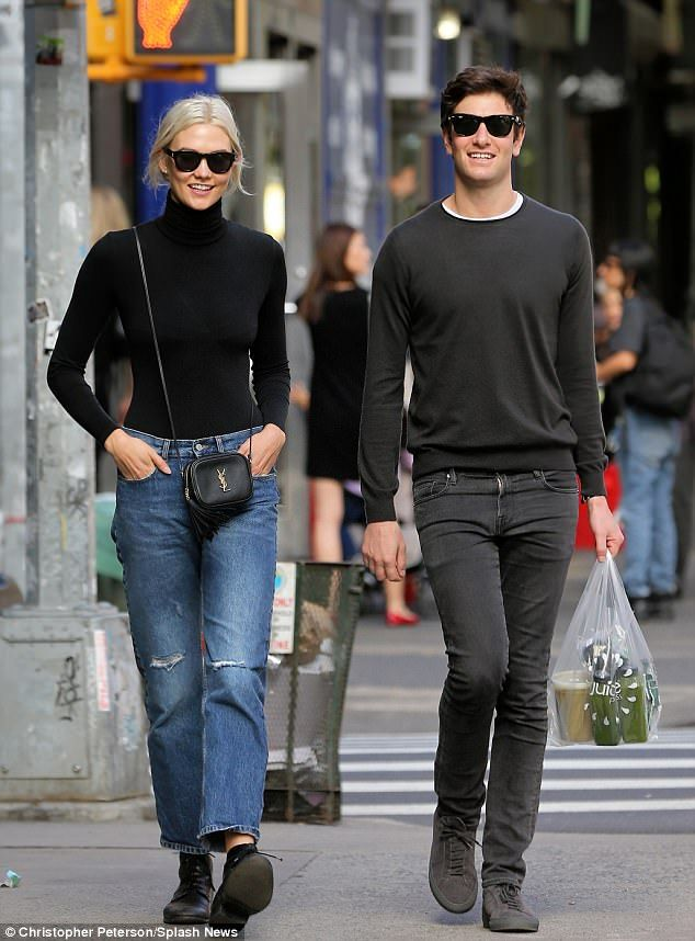 Matching sunglasses: Karlie Kloss and her boyfriend Joshua Kushner made a rare couple appearance during a juice run in Manhattan's West Village on Sunday