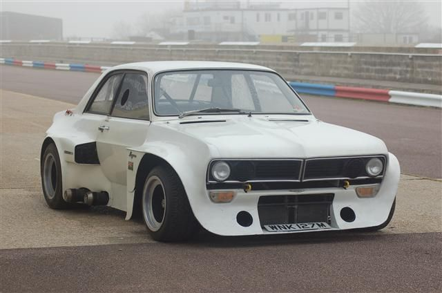 """""""John Pope Special"""" Aston/Vauxhall build, 1974 – The John Pope Special Vauxhall Magnum bodied, powered by an Aston Martin DBSV8, twin turbo charged super sports saloon. Add a hi-spinning turbo to each bank of cylinders, so that the engine produces close to 900 HP."""