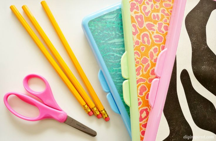 Repurposed Baby Wipe Container turned back to school pencil boxes, a fun craft for kids.