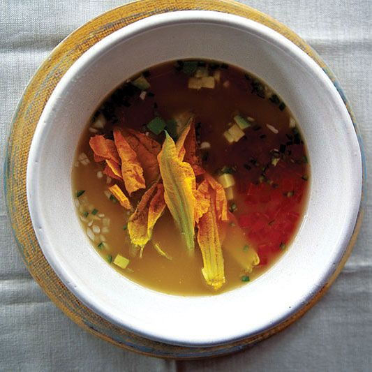 Caldo Xóchitl con Flor de Calabaza (Squash Blossom Soup)  Mexico's soups are famous for their freshness and simplicity. This one marries delicate squash blossoms with chiles, queso fresco, and shredded chicken in an enriched chicken broth.