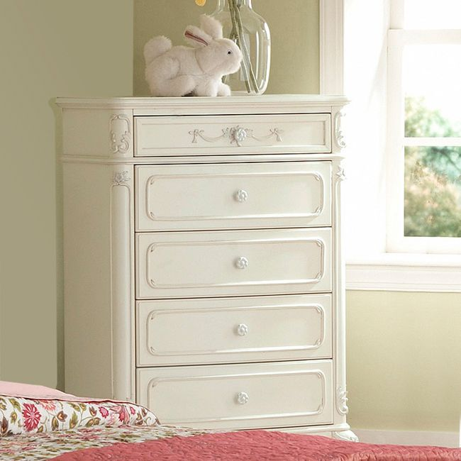 This kids' furniture set features Victorian styling with floral motif hardware, ecru painted finish and traditional carving details that create the feeling of a princess. This Fairytale Collection chest offers multiple drawers for plenty of storage.