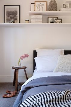 Adore Magazine - bedrooms - shelves over bed, We're moving - into a smaller apartment! What ways can we save on space? Look up! Let's maximize our vertical space by adding shelves. Bonus: they look nice too.