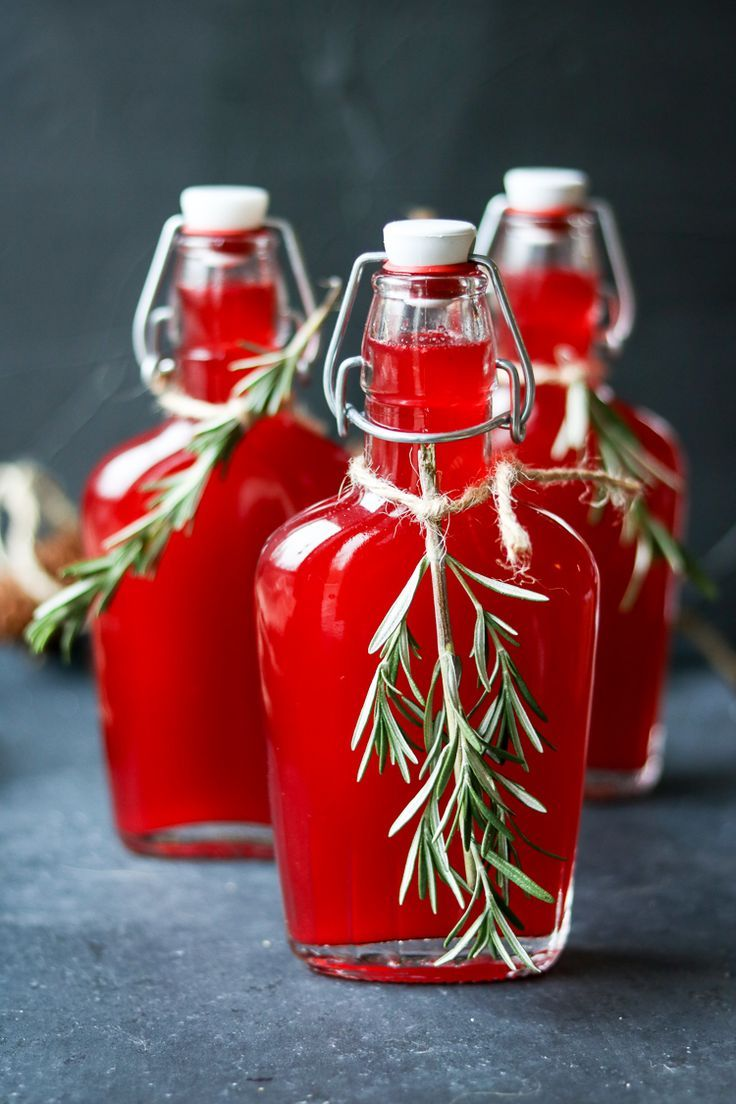 Vodka infused with FRESH cranberries, mixed with rosemary simple syrup. Such a great gift idea -  just pour over ice and top with sparkling water. YUM!