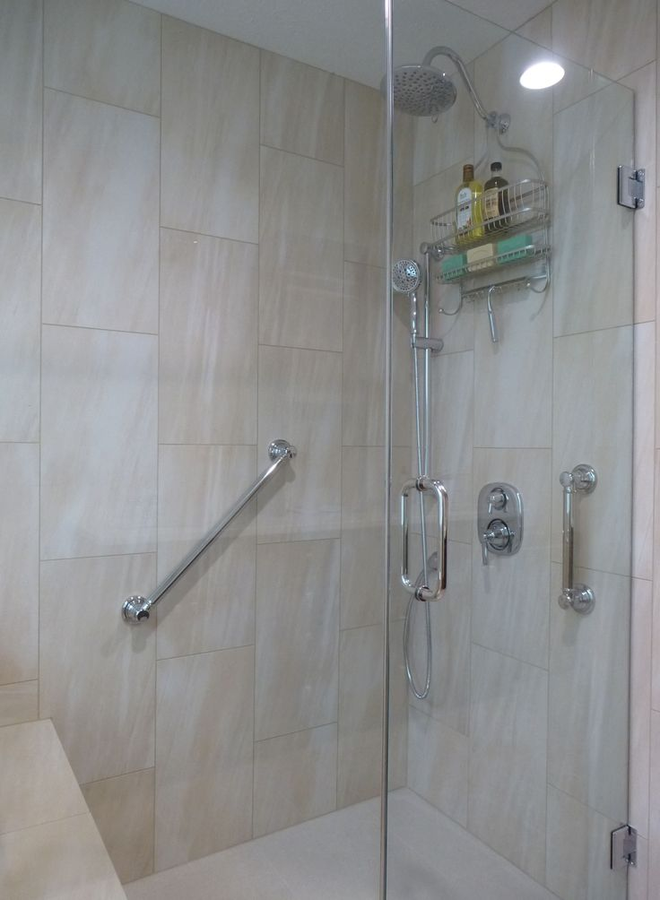 "Walk-in shower. Grab bars, 24- & 12-inch Brizo ""Providence Belle"" style.  Moen shower.  Overall cost of bathroom, including gutting, new walls/ceiling, Congoleum floor tiles, tiled shower with ledge seat, Kohler toilet/faucets, StarMark cabinetry (cherry wood with Hazelnut stain), Vicostone quartz countertops in ""Taj Mahal"", plumbing not moved:  $21,000. I have about $1,500 in the mirrors, towel racks, etc., from Rejuvenation.com."