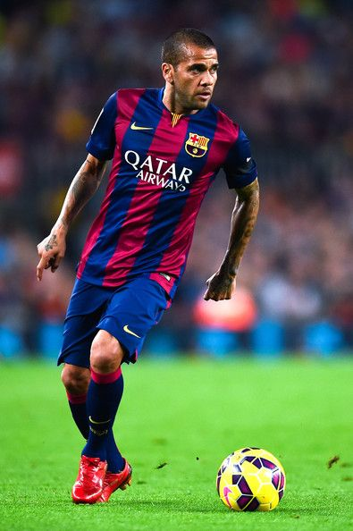 Dani Alves of FC Barcelona runs with the ball during the La Liga match between FC Barcelona and Celta de Vigo at Camp Nou on November 1, 2014 in Barcelona, Spain.