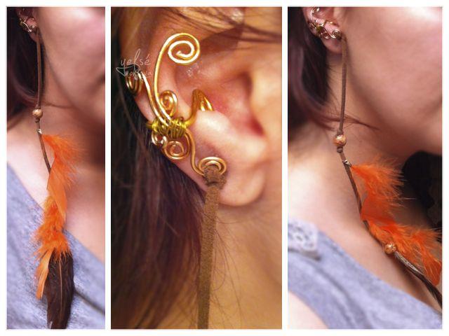 Ear cuff naranja realizado en alambre de aluminio, y plumas de marabú y faisán, con adornos en madera