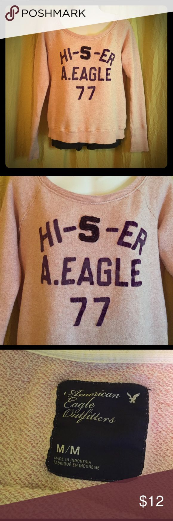 American Eagle sweatshirt Light pink American Eagle sweatshirt with purple lettering. Some cracking to the lettering gives it a worn in look. Very comfy! American Eagle Outfitters Tops Sweatshirts & Hoodies