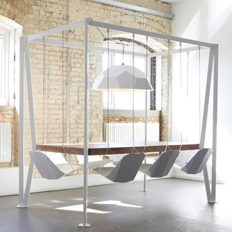 I once ate at a restaurant with swing chairs - really fun and cool. :) Swing Table created for Duffy London. The table part is stable, I believe.