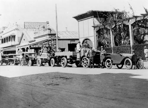 Motor vehicles in front of Whitaker's Motor Works and the Wintergarden Theatre in Kent Street, Maryborough, ca. 1926. Shown in photograph from left to right are - Nash cars, Joe Brown with his timber truck, Walkers' Limited Leyland truck with solid rubber tyres (Sam Whitaker is leaning on the mudguard of this truck) and Harry Randall leaning on his Austin.