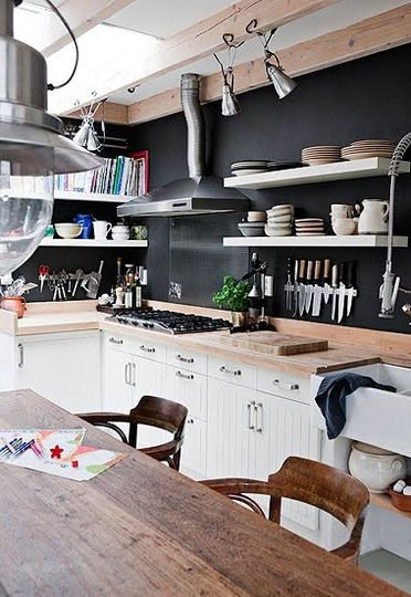 a black backdrop is a fresh update for white cabinets and wood worktops Apartment Therapy via Desire to Inspire