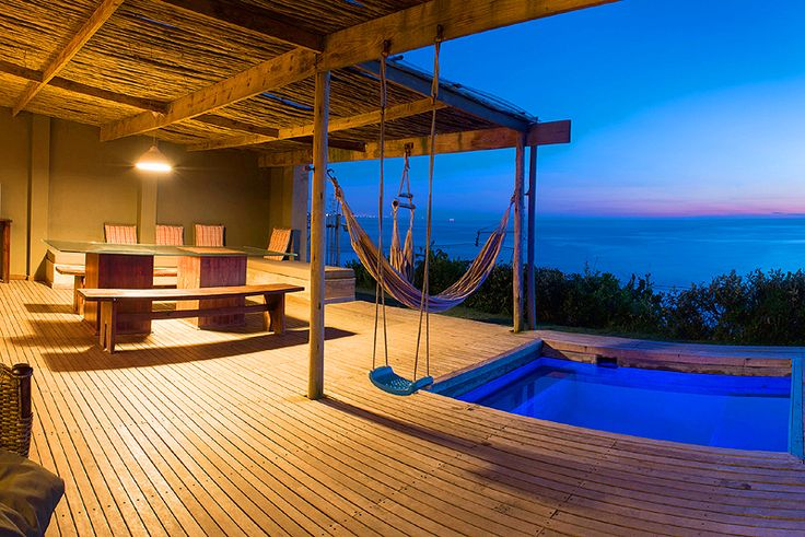 HIGHROCKS - Voted Top Ten Beach House by the Getaway Magazine! Self catering holiday home in Widenham, South Coast, KZN Highrocks is an easy drive down the south coast from Durban of approximately 40 minutes. As you enter the property you see the vast ocean before you, the lounge is double volume and the 80 year old eaves are exposed.  From there you walk onto the deck and the ocean literally rolls out below you onto the horizon.