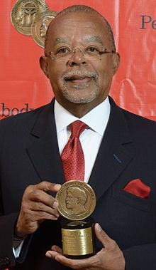 """Henry Lewis Gates Jr. with his Peabody Awards for his documentary, The African Americans: Many Rivers to Cross. Henry Louis """"Skip"""" Gates, Jr., (born September 16, 1950) is an American literary critic, educator, scholar, writer, and editor. He was the first African American to receive the Andrew W. Mellon Foundation Fellowship. He has received numerous honorary degrees and awards for his teaching, research, and development of academic institutions to study black culture."""