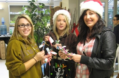 Event management students Michelle Oswell, Michelle Pollock and Amber Rae weren't mixing the seasons--a Halloween candy bag was just handy for delivering candy grams. The class sold 200 Christmas candy canes as a fundraiser. They also spread some extra Christmas cheer delivering their leftover stock to Hemstock seniors home residents. Dec 2011