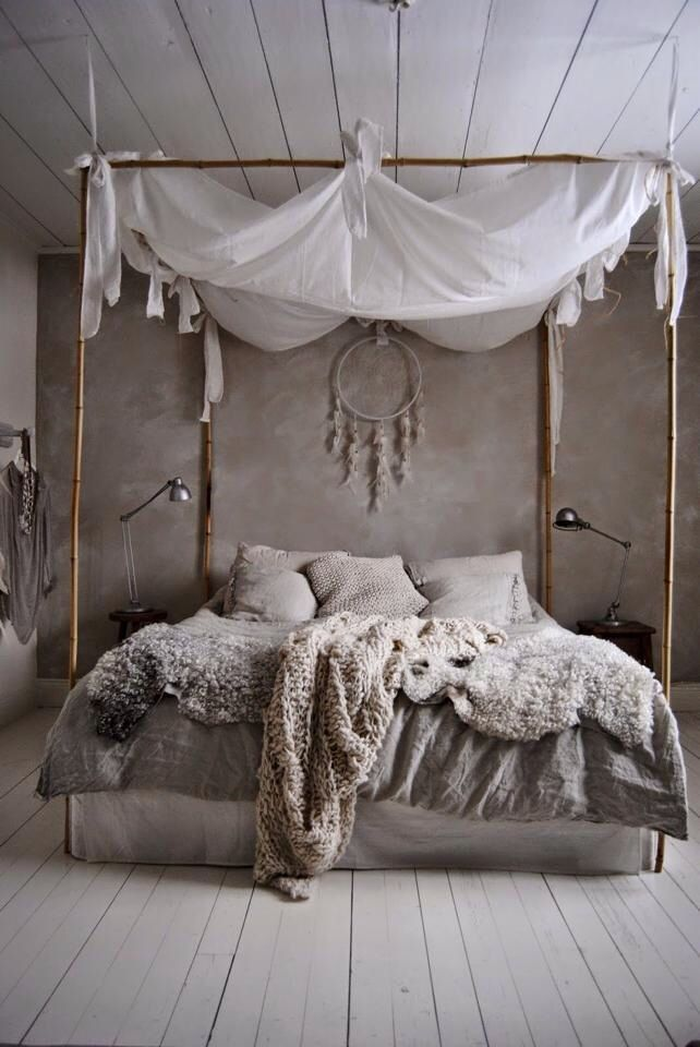 American-Indian inspired bedroom, dream catcher floats at the head of a  beautiful faux