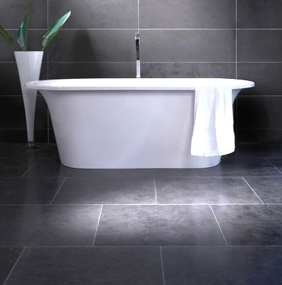 Large grey tiles for floor and walls.