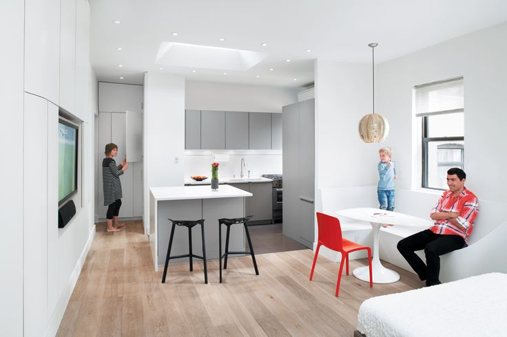 When Svetlin Krastev and Dessi Nikolova renovated the architects, Ferda Kolatan and Erich Schoenenberger of su11 architecture + design, installed a laminate storage wall that stretches and curves from the entranceway all the way to the boys' room. The floor-to-ceiling cabinets contain almost all the family's possessions, from clothing and shoes to books and bedding. http://www.dwell.com/house-tours/article/all-together-now