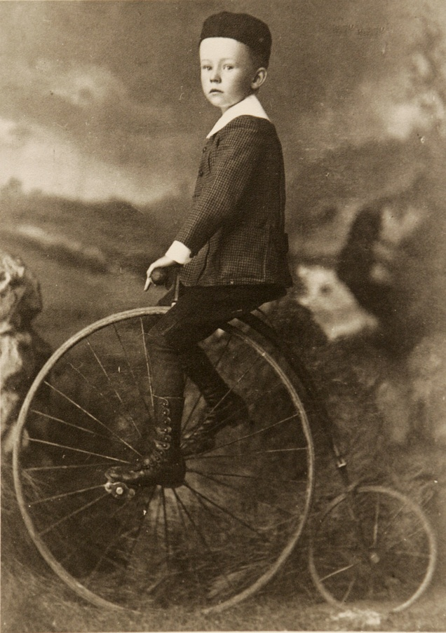 Little boy on an old-fashioned bicycle. Courtesy of Utah Historical Society