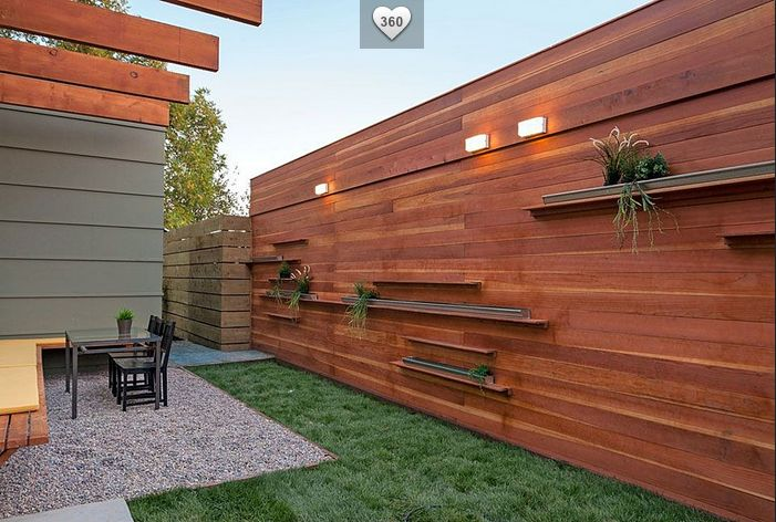 Love the fence design with lighting & built in shelves
