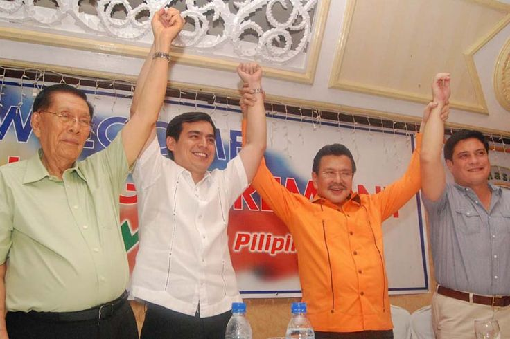Senate President Juan Ponce Enrile (left) and former President Joseph Estrada (2nd right) raise the hands of Manila Vice Mayor Isko Moreno (2nd from left) and former Senator Juan Miguel Zubiri (right) after their oath-taking as new members of the Pwersa Ng Masang Pilipino (PMP) at Club Filipino in San Juan City on Thursday.