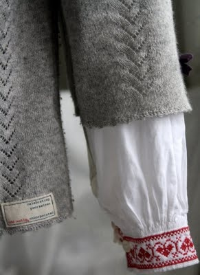 folk art stitching - felt old jumpers & cardigans and then cut the sleeves off them & embroider them.