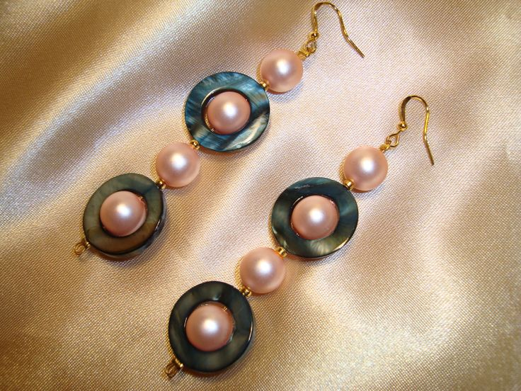 earrings with salmon pearls and rings of ivory.  https://www.facebook.com/pages/Handmade-Creations-by-Efi/187659788043676