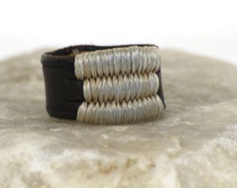 This is a made to order ring. Just leather, wood beads and nylon waxed thread. Hand dyed and hand stitched.