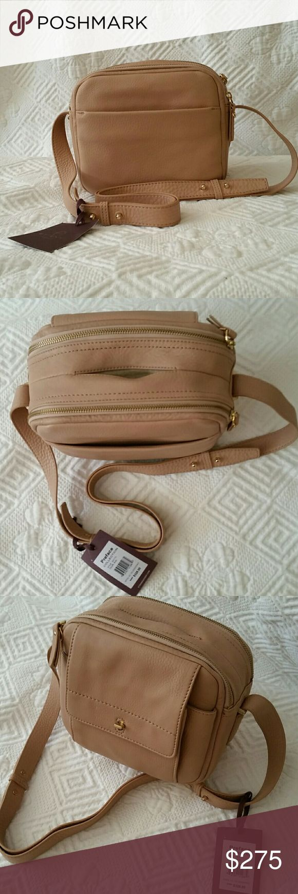 Aigner Preface Leather Handbag Aigner Preface Collection gorgeous leather handbag,with a slit in between the two zippers for your cellphone. No more opening your purse for your  phone. Strap length 16in. Very roomy bag. Aigner Preface Collection  Bags Shoulder Bags