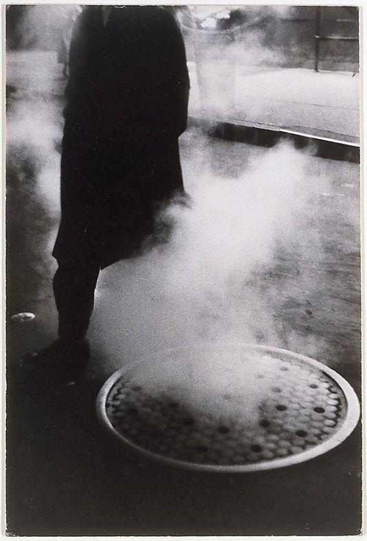 Louis Stettner, Man Near Manhole, Times Square, New York, 1954.