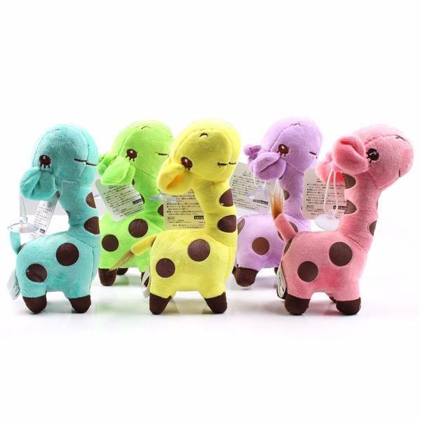 Plush Giraffe Toy. This Stuffed Giraffe comes in Pink, Purple, Teal, Green and Yellow