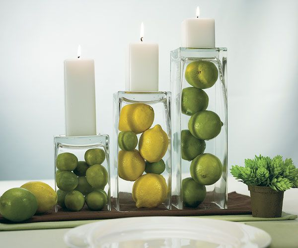 Citrus, vases and pillar candles