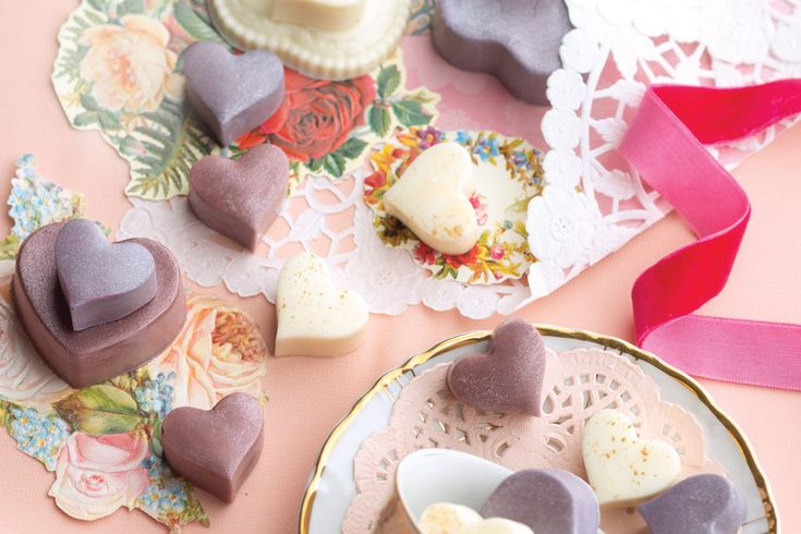 Elegant tokens of confection, Moulded White Chocolate Hearts shelter a smooth filling flavored with orange extract and elderflower liqueur.
