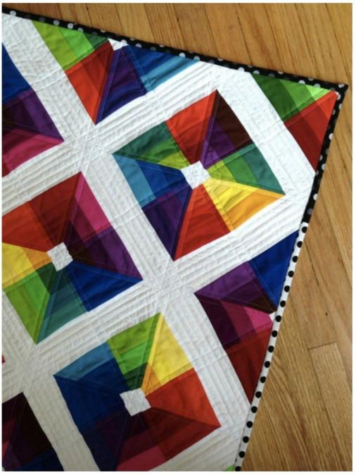 A stunning work of art w/ bold colors & character. A rainbow-inspired quilt pattern