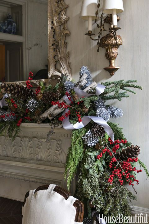 Here's a tip for incorporating garlands into your home this Christmas. Layer them! Include other wintry greens like spruce, birch twigs, winterberry and silver pinecones for an added touch of flair. Click through for more ways to upgrade plane old pine this year for your best Christmas garland yet.
