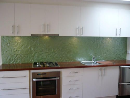 Glass textured look splashback. Not so keen on the colour but love the texture.