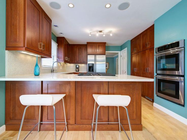 See pictures of colorful kitchens at HGTV for ideas and inspiration on using color in the kitchen.