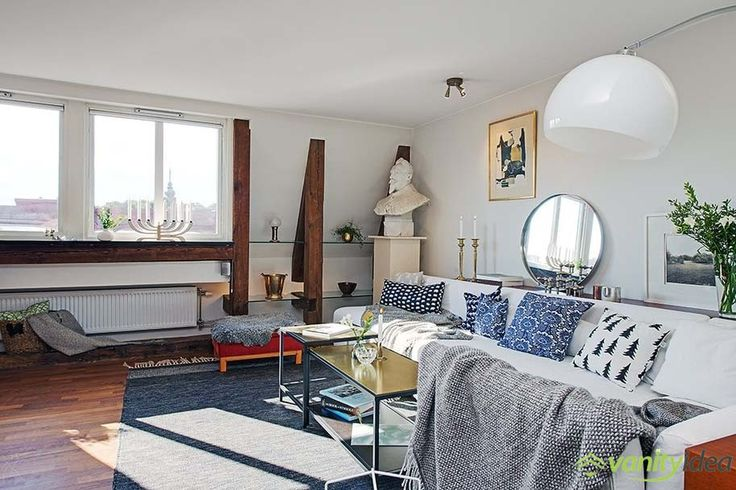 blue carpet, white sofa with blue cousins