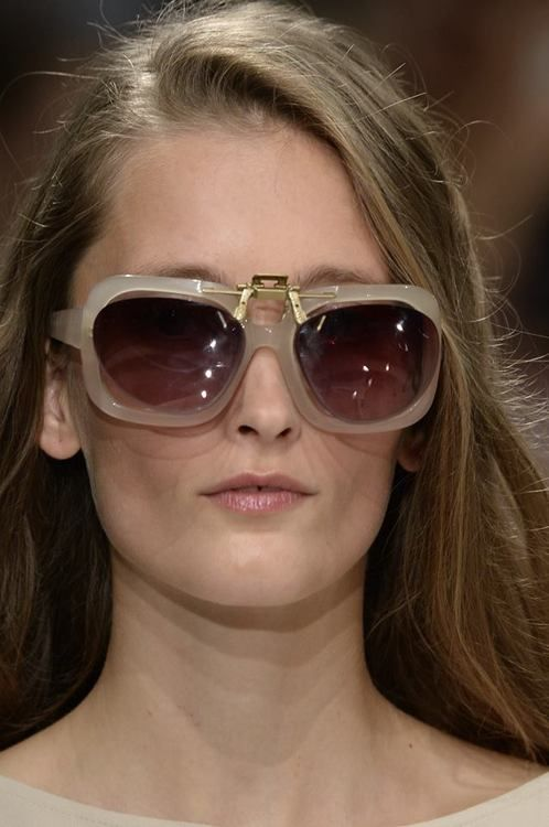 Articulated sunglasses with polychromatic lenses, produced & engineered in General Eyewear's London studio for Hussein Chalayan's Spring / Summer 2014 Paris Show