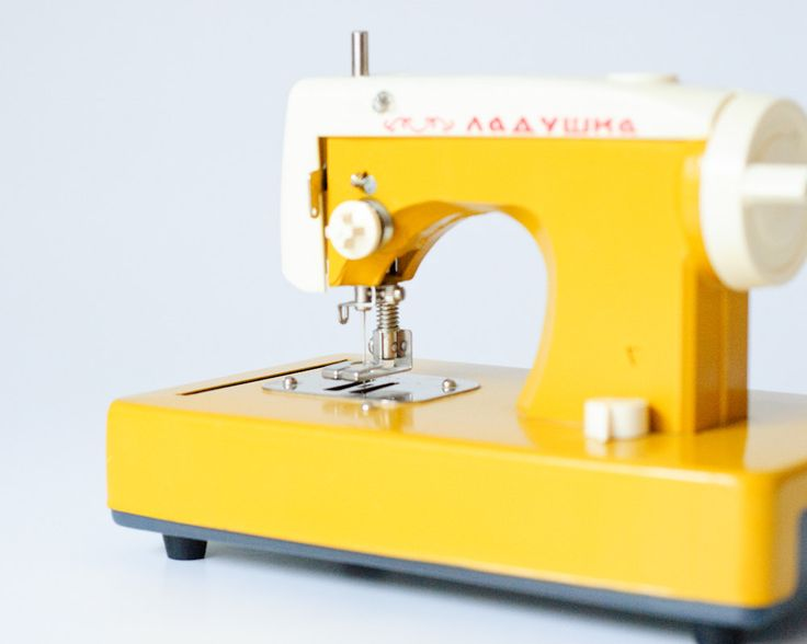 Toy Sewing Machine - Vintage - Made in USSR - Yellow Mustard - Ladushka - Nursery Decor. $90,00, via Etsy.