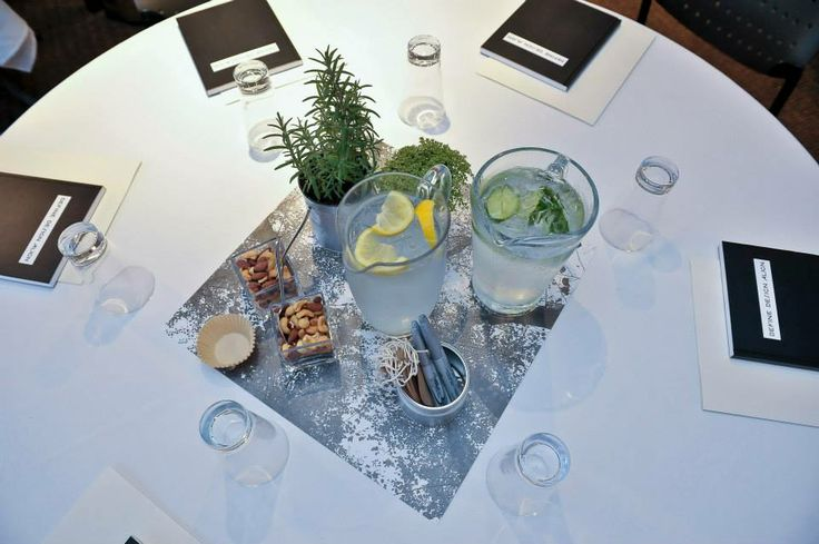 Table Centres - 'touch me' plants of Rosemary and Thyme.  Cucumber and lemon water for refreshment and nuts for nourishment.